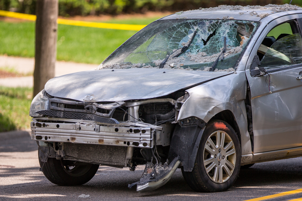 Emergency crews respond to 1900 block of Washtwnaw Avenue after a Ford Focus, driven by a 35 year-old male, crashed into the house on Tuesday, July 18, 2017. The driver of the car died and the cause of the accident is under investigation. Matt Weigand   The Ann Arbor News