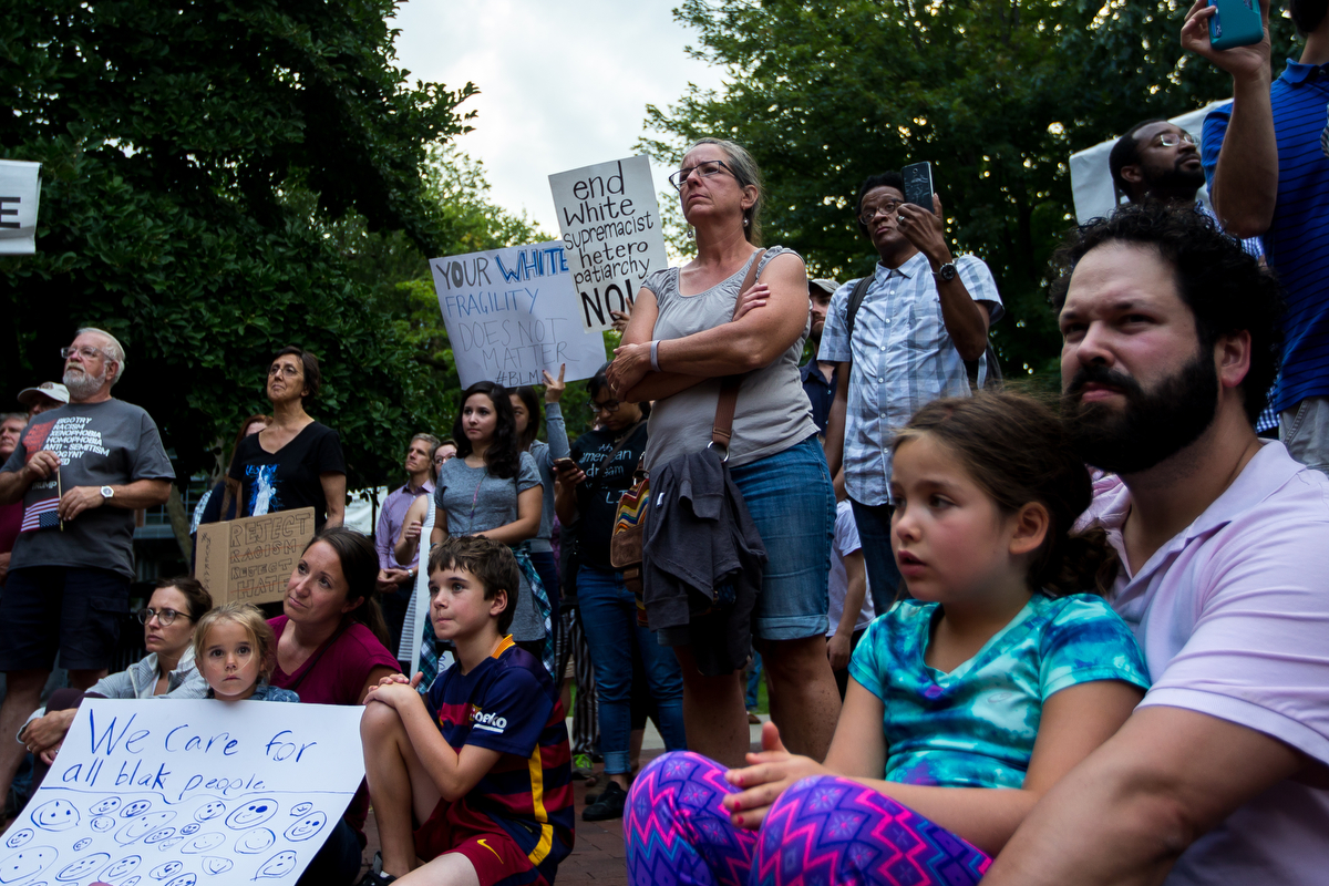 People come together for a gathering to stand in solidarity with the counter-protesters and victims of the protests and attacks in Charlottesville, VA that occurred on Saturday, August 12 while at the Diag at the University of Michigan on Sunday, August 13, 2017. Matt Weigand | The Ann Arbor News