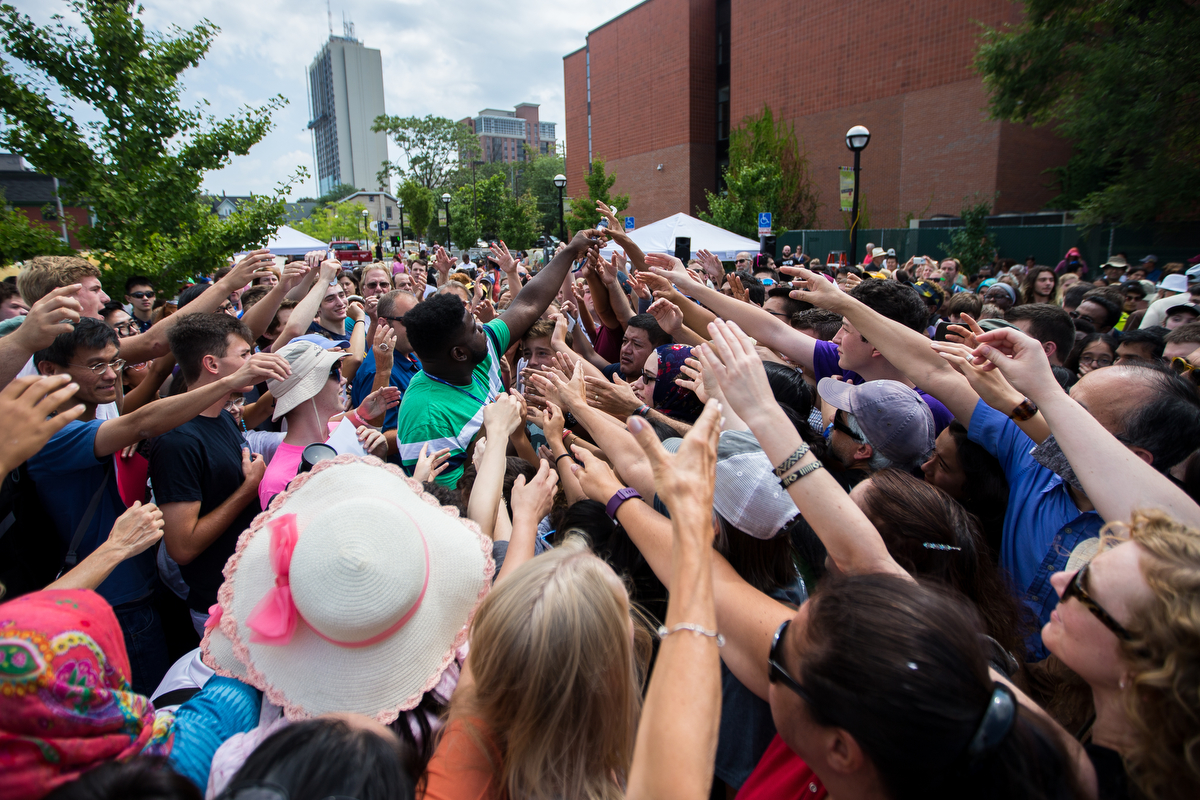 People push and fight to get one of 400 pairs of solar eclipse viewing glasses that were handed out at the Ann Arbor District Library ahead of the solar eclipse on Monday, August 21, 2017. The eclipse began at 1:02 p.m. and hit its max at 2:26 p.m. Matt Weigand | The Ann Arbor News