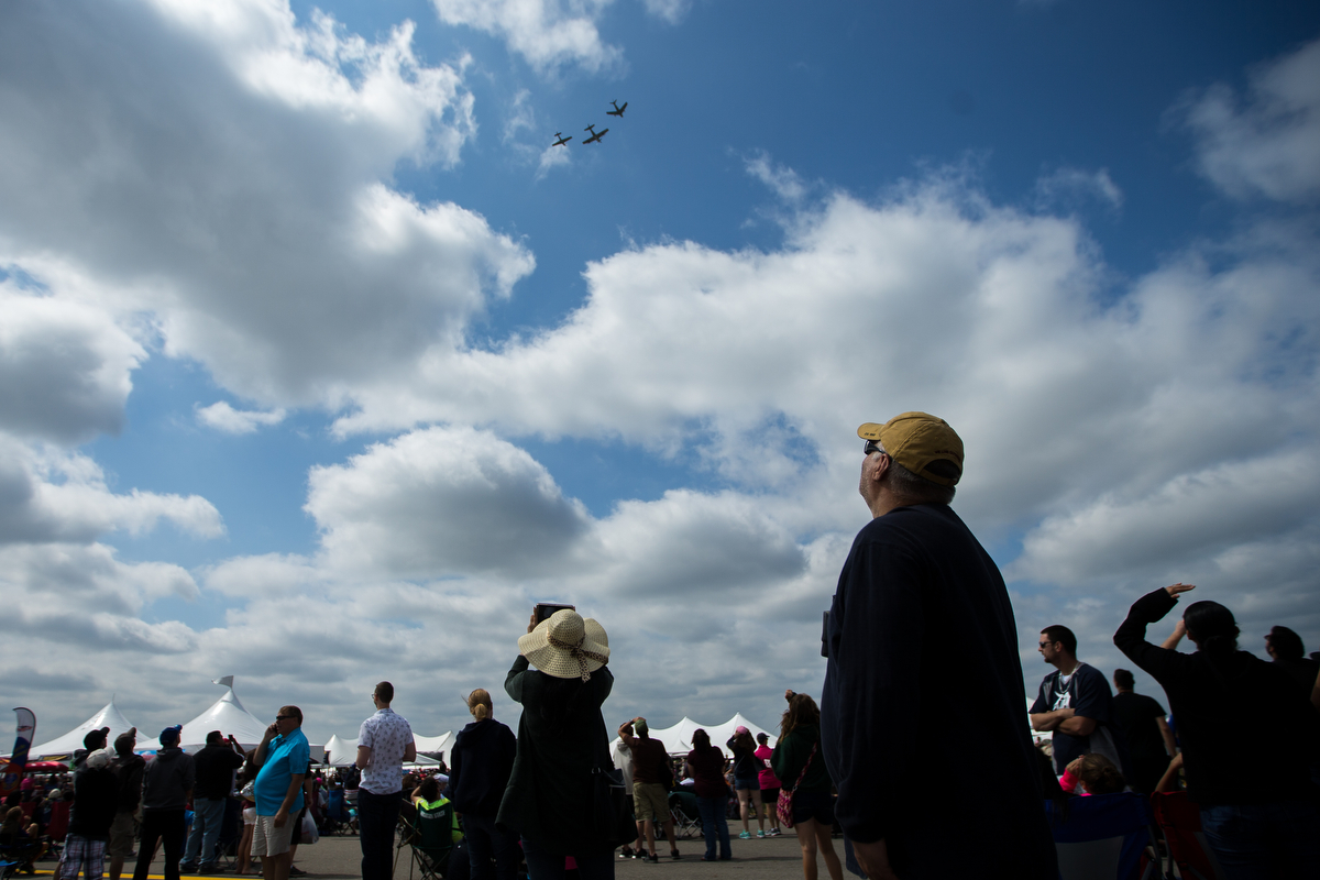 People look at airplanes flying at the Thunder Over Michigan Air Show at Willow Run Airport on Sunday, September 3, 2017. Matt Weigand | The Ann Arbor News