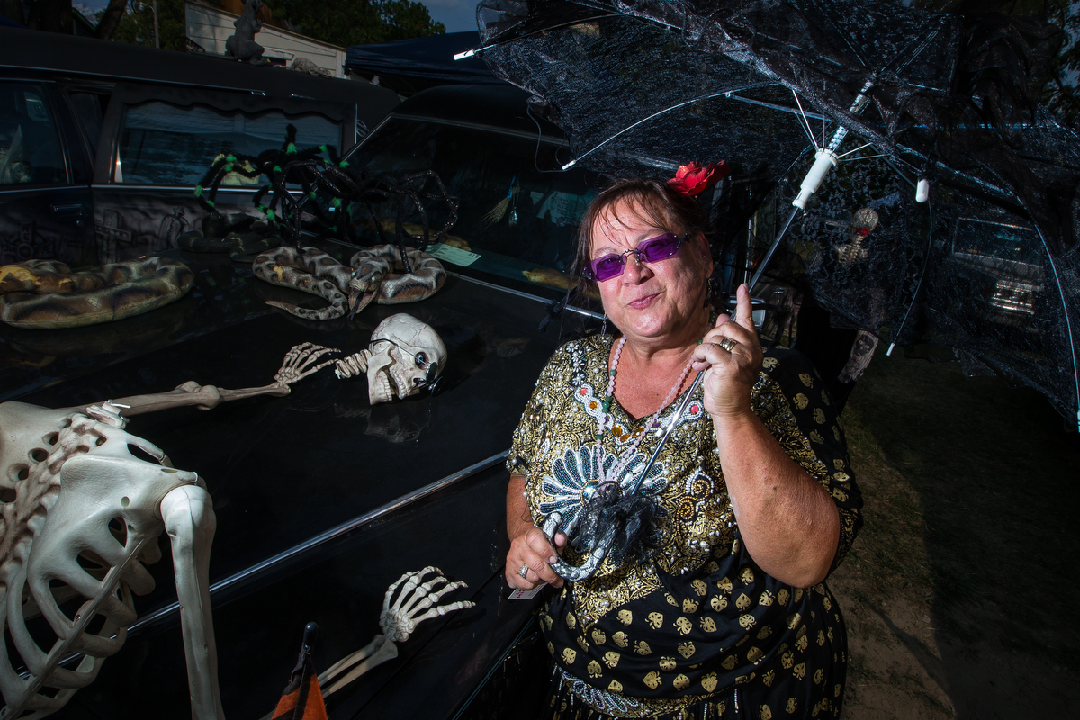 Santa Mata poses in front of her hearse during the 16th annual Hearse Festival in Hell on Saturday, September 16, 2017. The festival was free to everyone, welcomed all hearses and went on a cruise through the Terrified Forest in Pinckney. Matt Weigand | The Ann Arbor News