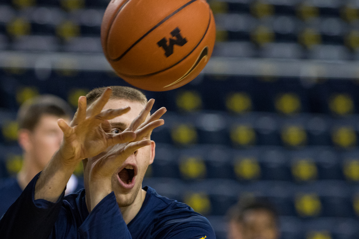 Michigan�s Austin Davis (51) passes the ball to a teammate while warming up before tip-off for the University of Michigan Armstrong State basketball game at the Crisler Center on Friday, November 4, 2016. Matt Weigand | The Ann Arbor News