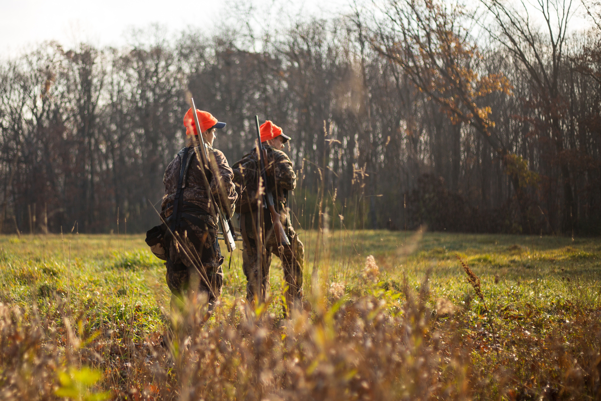 Ricky Taylor, 12, left and his father Rick walk through a meadow while hunting near Chelsea on Tuesday, November 16, 2016. Rick took his son Ricky hunting on opening day of deer hunting for his first time hunting with a rifle. Matt Weigand | The Ann Arbor News