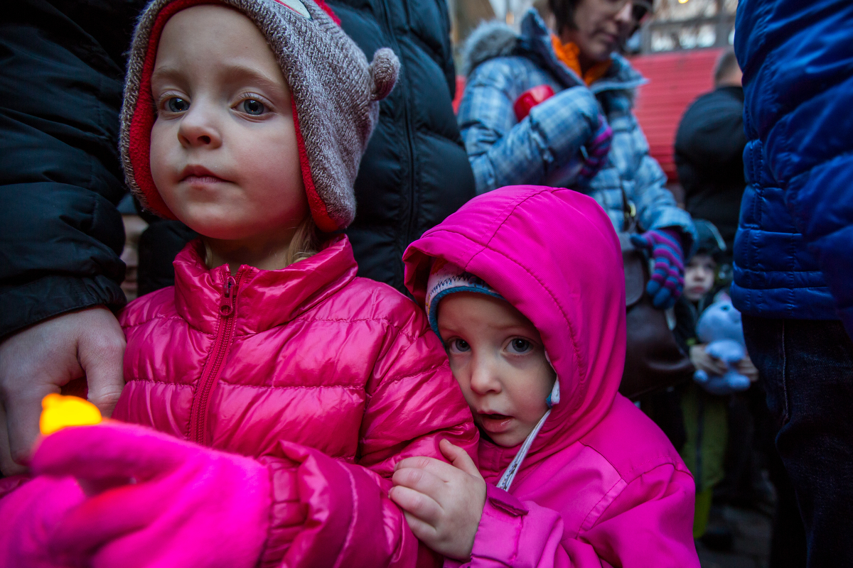 Corinne Marks, 6, left and her younger sister Truett, 4, eagerly wait the arrival of Santa at the Kerrytown Christmas tree lighting on Sunday, November 27, 2016. The lighting, which took place at the Kerrytown Market and Shops, featured singing from the Pioneer High School choir, a tree lighting and a visit from Santa. Matt Weigand | The Ann Arbor News