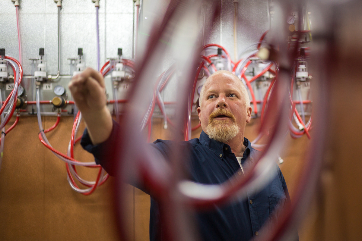 Michael Holloway, food and beverage director at Siris Restaurant, talks about their 120 tap Beer Saver system on Thursday, December 8, 2016. The restaurant, which plans to open mid winter 2017, will be a barbecue, craft beer bar and a cigar lounge. Matt Weigand | The Ann Arbor News