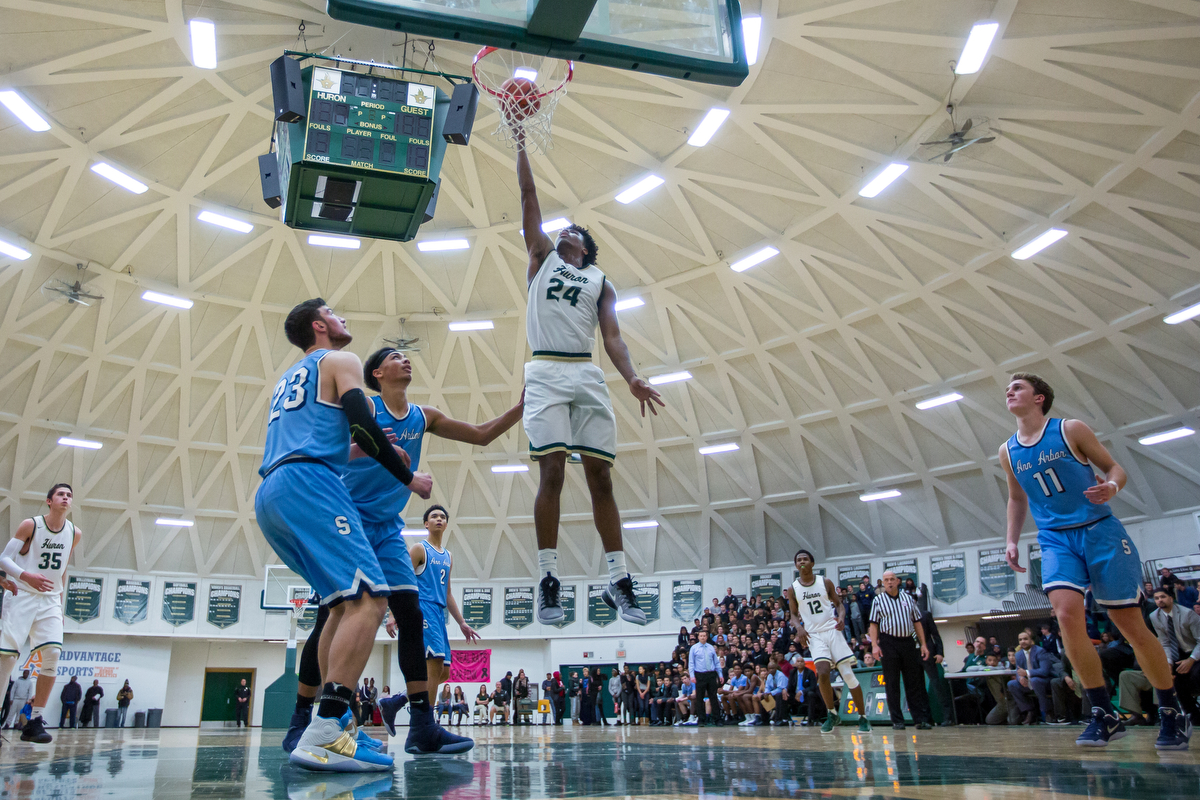 Huron High School's Lawrence Rowley (24) dunks the ball during the second half of play against Skyline High School at Huron High School on Friday, December 16, 2016. Skyline High School beat Huron High School 95-92 in triple overtime. Matt Weigand | The Ann Arbor News