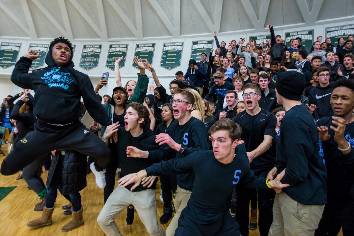 Skyline High School students react after Skyline beat Huron High School in triple overtime at Huron High School on Friday, December 16, 2016. Skyline High School beat Huron High School 95-92 in triple overtime. Matt Weigand | The Ann Arbor News