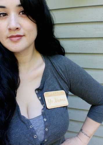 "Thea wearing a 6 by 6 Arts "" Hello My Name Is... "" Name Badge."