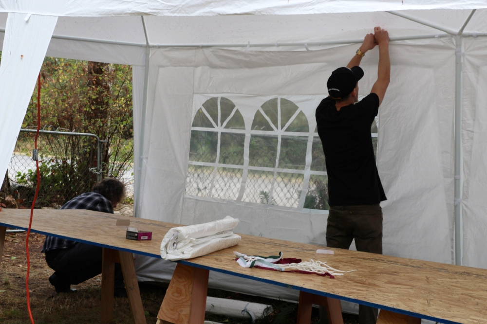 Our very good friend Chris and our eldest son Calvin setting up the tents and the long tables.