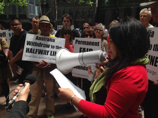 Mica Barreto Soares addresses the crowd in Melbourne