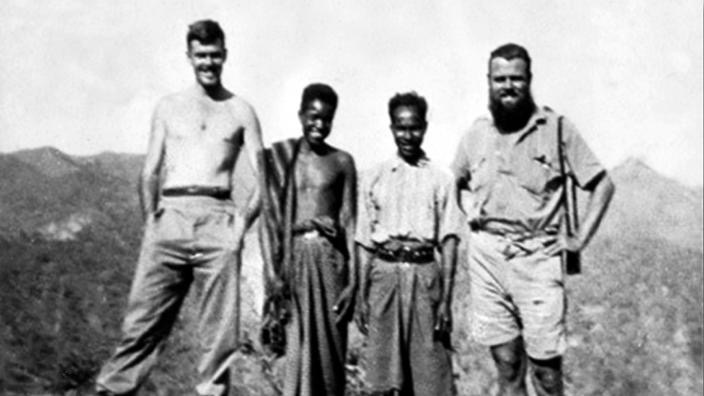 Australian soldiers and their loyal companions:  Tom Nisbett, Evaristo, Rufino Alves Correia, Geoff Laidlaw