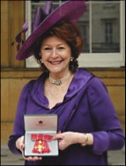 Gillian receiving her OBE