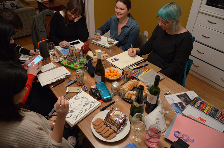 (pictured here, from the right around the table is  Lena Podesta, Adrienne Vita, Vera Brosgol, Peg Serena, Tara Lilly, Kinoko Evans, and the little blue person on pink paper is by Rilla Alexander)