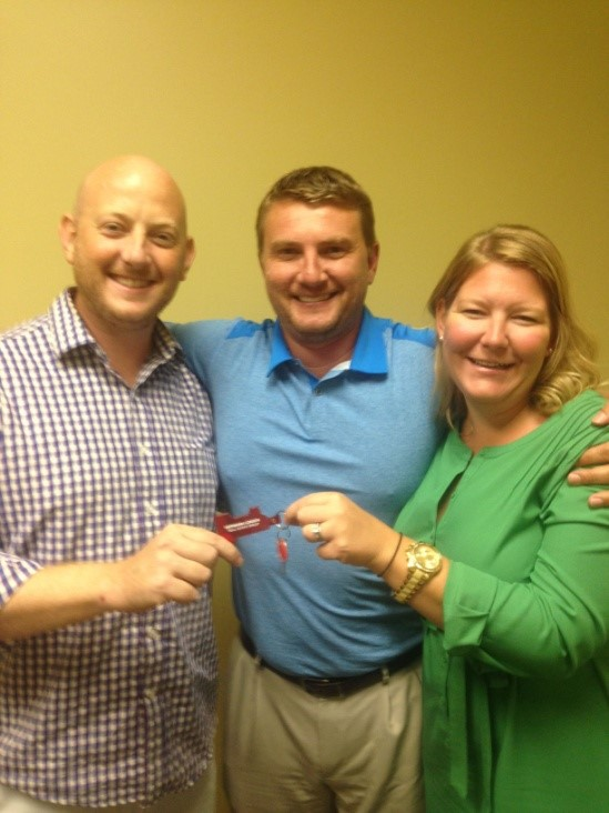 Melissa and her husband (the happy homeowners!) with their agent