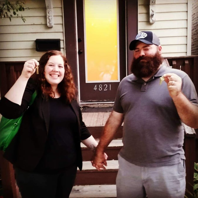 Katie and husband, Andrew, in front of their home.  Photo submitted with approval by Katie M.