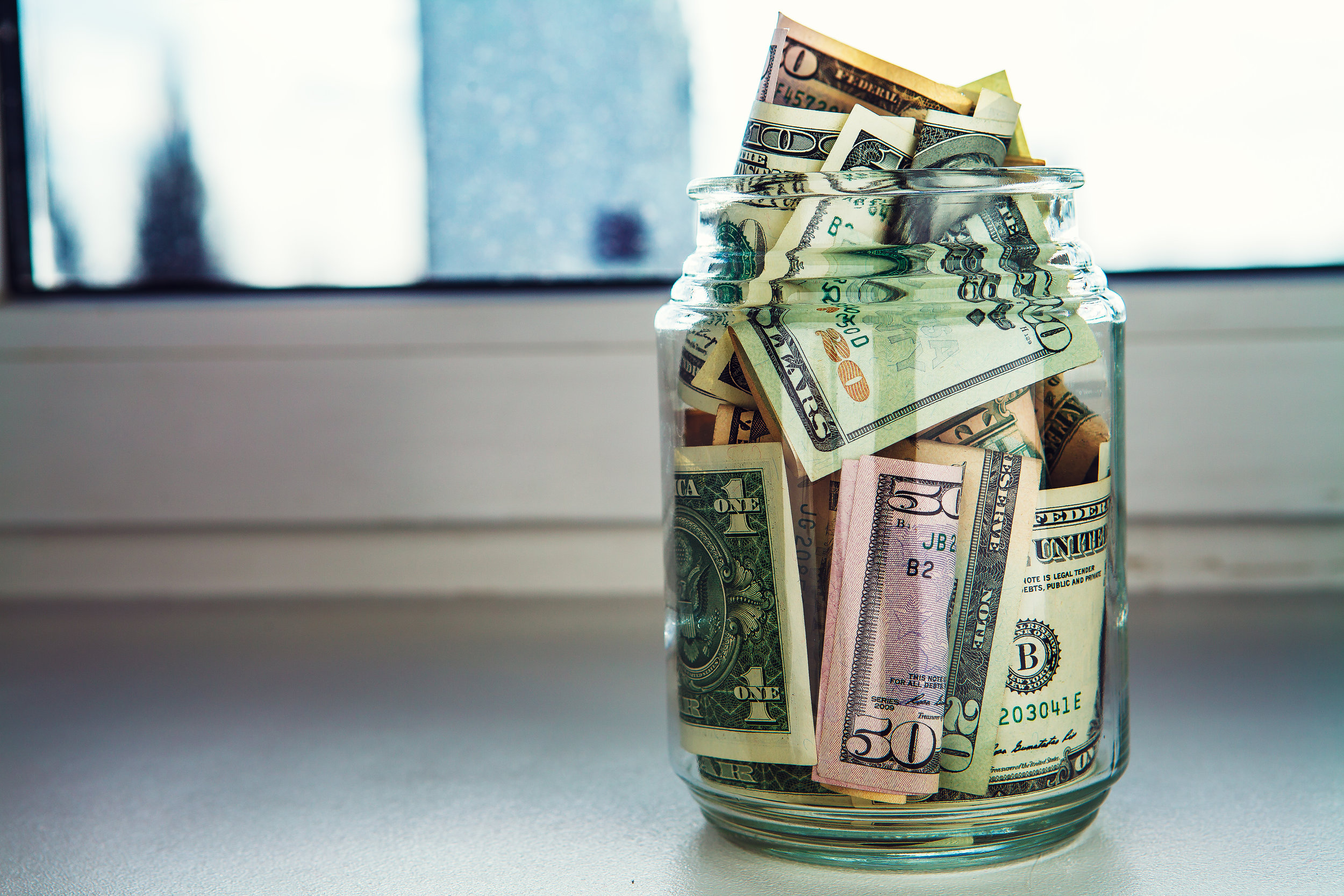 We're not opposed to saving some cash in a jar, but why keep it there when you can earn interest with a financial institution?