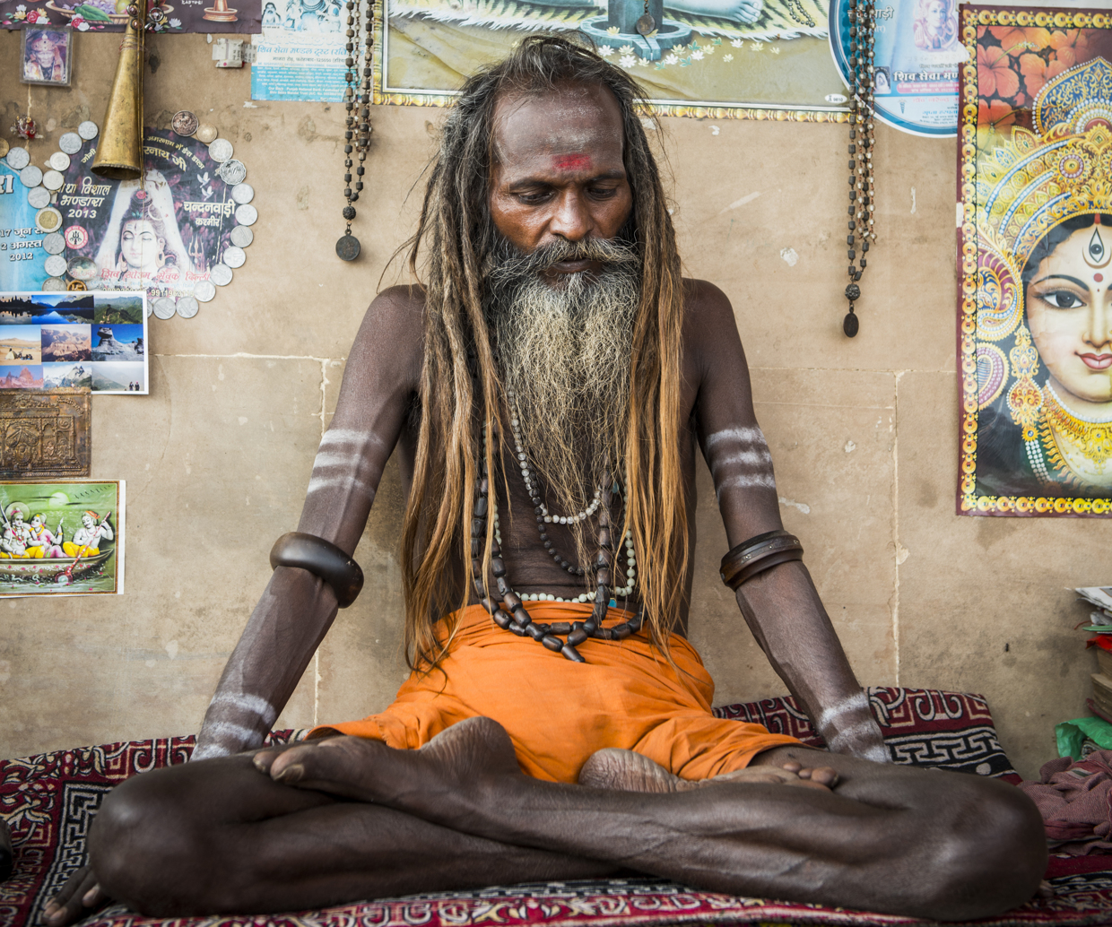 A man meditating by one of the many ghats in Varanasi, India.