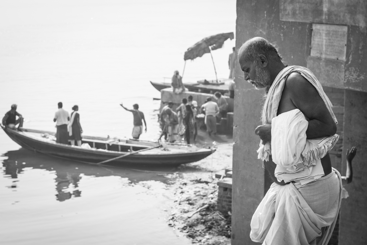 A man gets ready for his bath in the river Ganges.