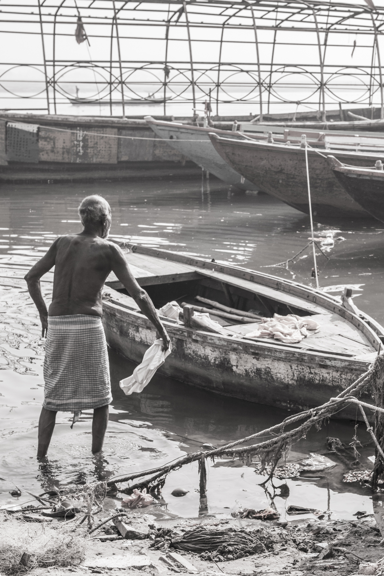The holy river of Ganges is used for pretty much everything. This man is cleaning his clothes after a bath.