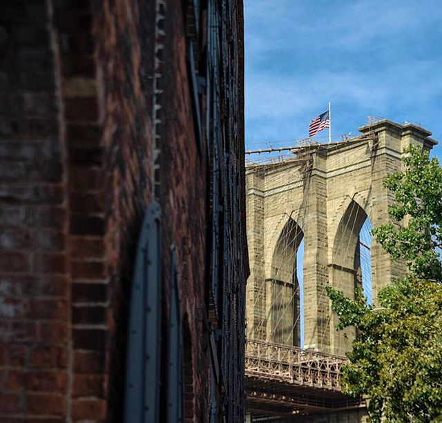 The US flag at half-staff on Brooklyn Bridge to honor 9/11 victims.  #9_11 #nineelleven #halfstaff #usa #usflag #brooklynbridge #brooklyn #honor911 #september11 #newyork #travel #streetphotography #nikon #nikond750 #lightroommobile