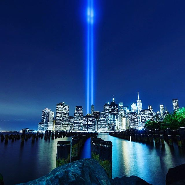 The Tribute in Light is an art installation of 88 searchlights placed next to the site of the World Trade Center to create two vertical columns of light to represent the Twin Towers in remembrance of the September 11 attacks.  #remember911 #tributeoflight #manhattan #newyork #twintowers #brooklynpark #manhattanskyline #skyline #cityscape #nighttime #usa #september11th #reflections #nikon #nikond750 #travel #travelphotography