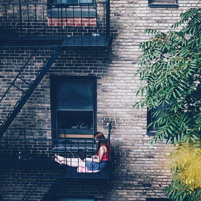 Balcony office in New York City. #balcony #studying #student #newyork #manhattan #office #outdooroffice #peopleofnyc #apartment #newyorklife #usa #nikon #nikond750 #street #streetphotography #travel #travelphotography