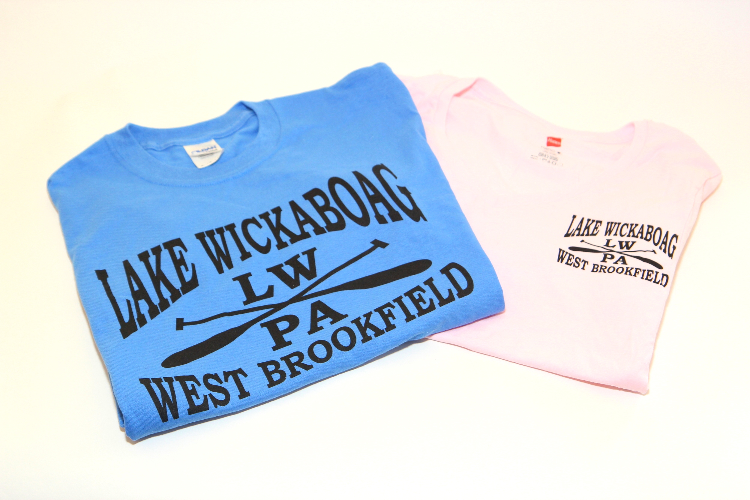 New Logo Tee shirts in soft pink and blue $15 - $20