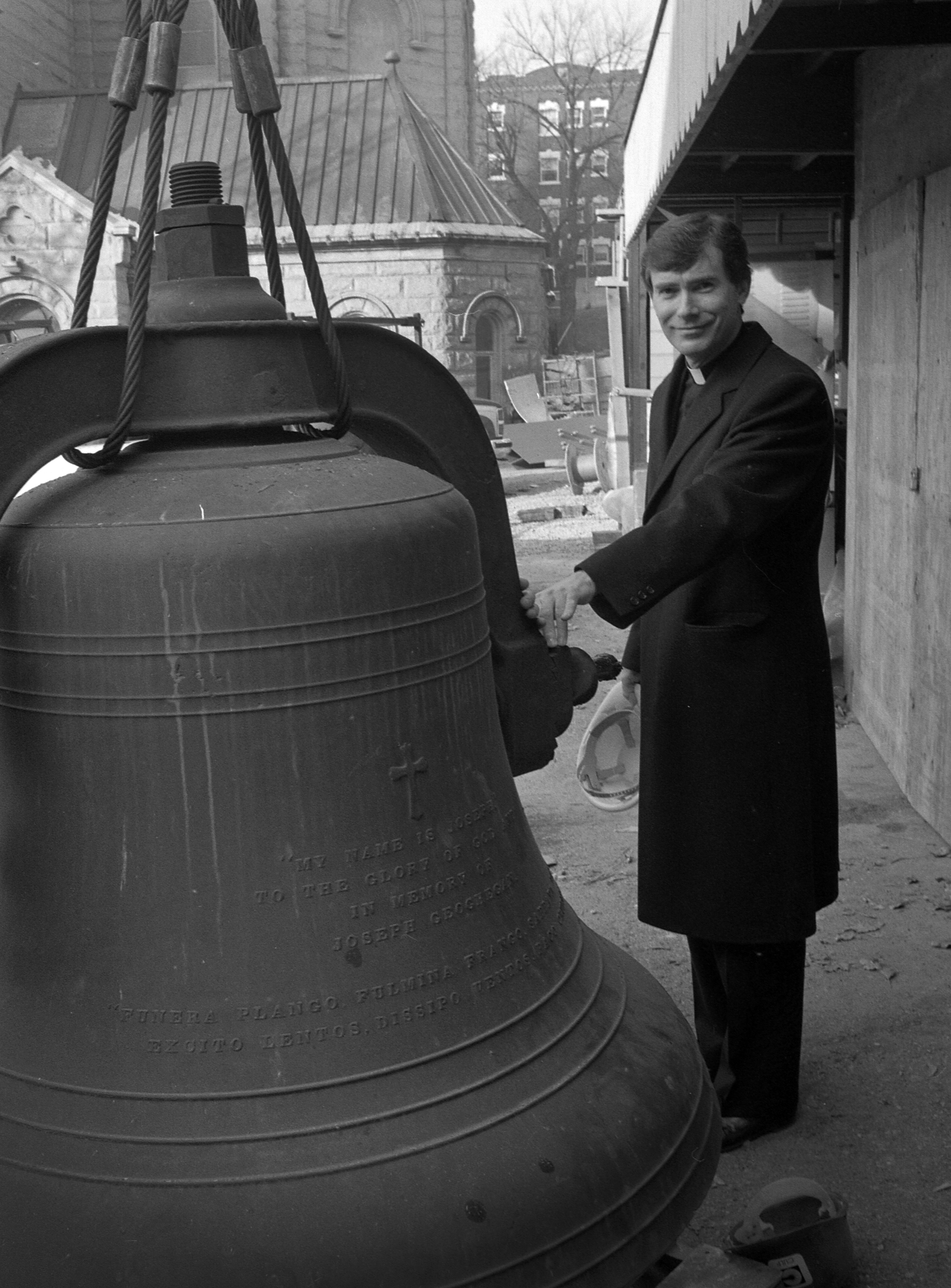 Msgr. M. Francis Mannion with the Cathedral bells.