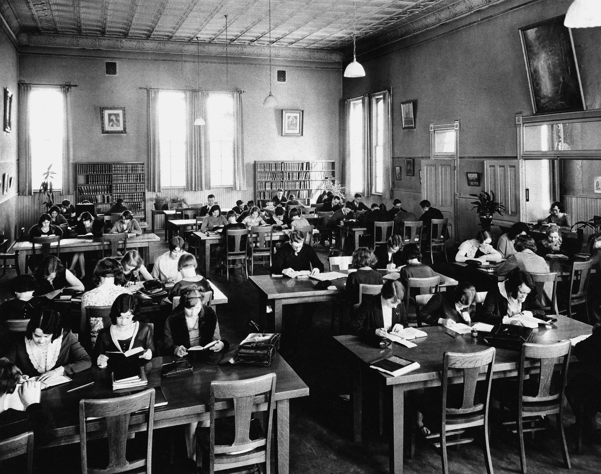 The Moench Building as it appeared in the early 1900s. The building was part of the Weber Stake Academy campus which, prior to becoming a state college in 1933, was a church school run by the Church of Jesus Christ of Latter-day Saints. If you look closely at this image of the Moench Building reading room you will notice a painting portraying an angelic figure visiting the young Joseph Smith. Images courtesy Weber State University Archives.