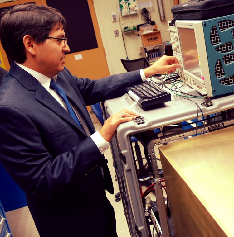 Dr. Nishimura examining picosecond laser pulse readouts at the NIST mini-timecube (MTC) test site in Gaithersburg, Maryland, 2015.