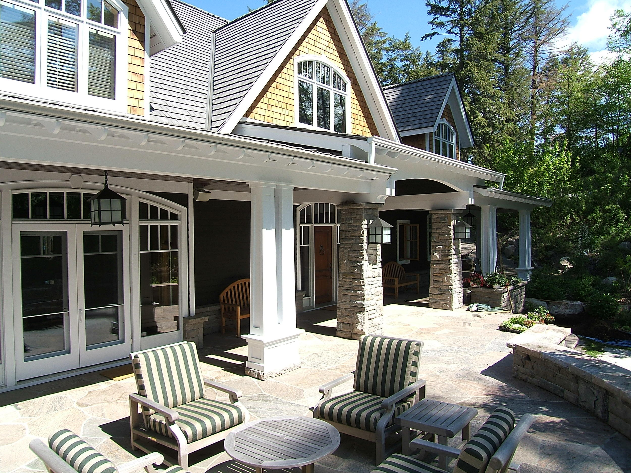 spacious backyard with patio chairs of a traditional house