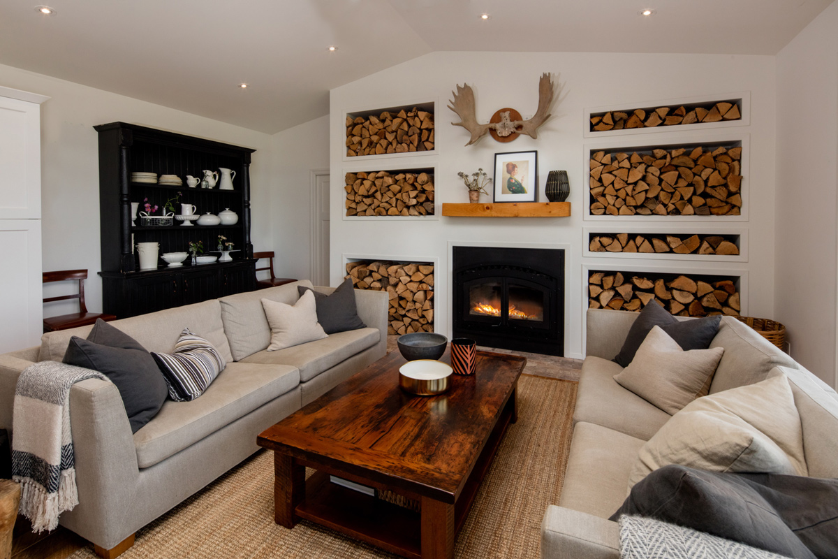cabin themed living room with beige sofas and wood furniture