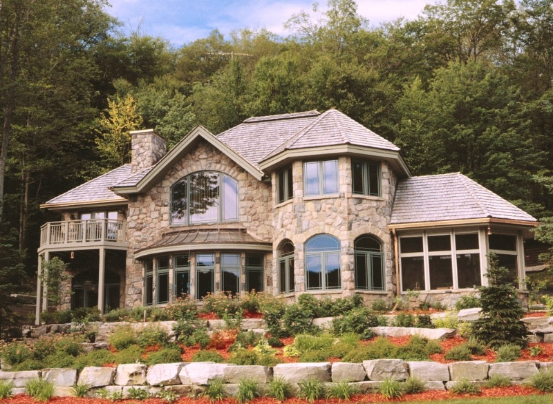 Luxury Stone House with a lot of Picture Windows