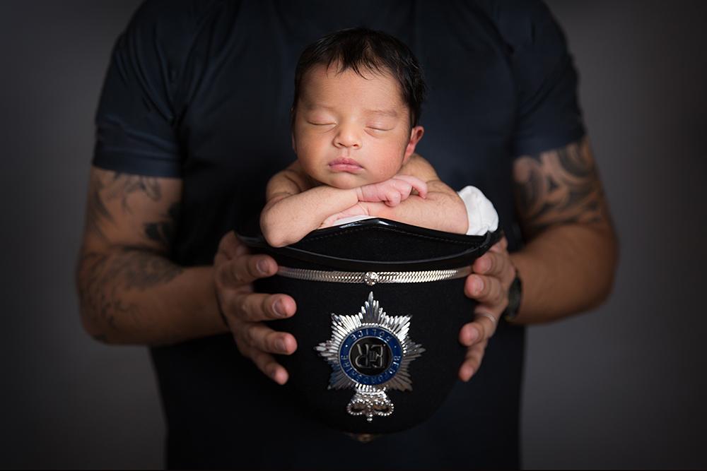 newborn photo police helmet Hertfordshire.jpg