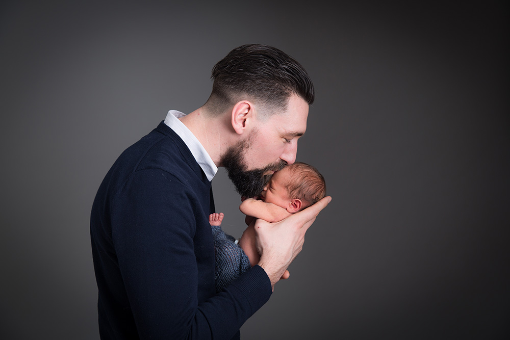 newborn photography father.jpg