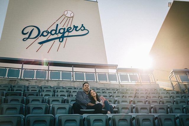 "Ernesto is a true blue Dodgers ⚾️ fan and when it came to planning the perfect location for an engagement session for he and his fiancée, I said, ""How about Dodger Stadium?""… ""No way?!"" he replied. Challenge accepted ✅ I had to make it happen. Dodger Stadium has been the location of many a date with Ashley, the love of Ernesto's life. Together, they enjoy the finer things... baseball, good food, and good beer! After taking in the beautiful, historic stadium in Los Angeles, which is truly a nod to a bygone era, the three of us headed down to the Arts District. We ended up heading into the Iron Triangle Brewing Company, where we enjoyed ice cold beers and conversation and then finished this session up in the glistening, golden hour, as the sun began to set. It was a joy to document such a perfect afternoon, as a way for this fun loving couple to always remember these happy times. Here's to many more! 🍻 Go Dodgers!! ⚾️ 💙"
