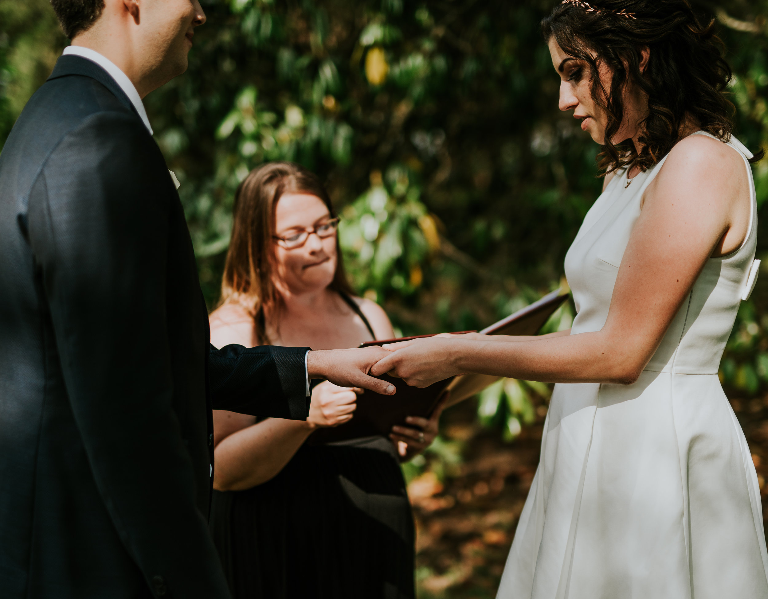 exchanging rings - Arianna Belle Photography