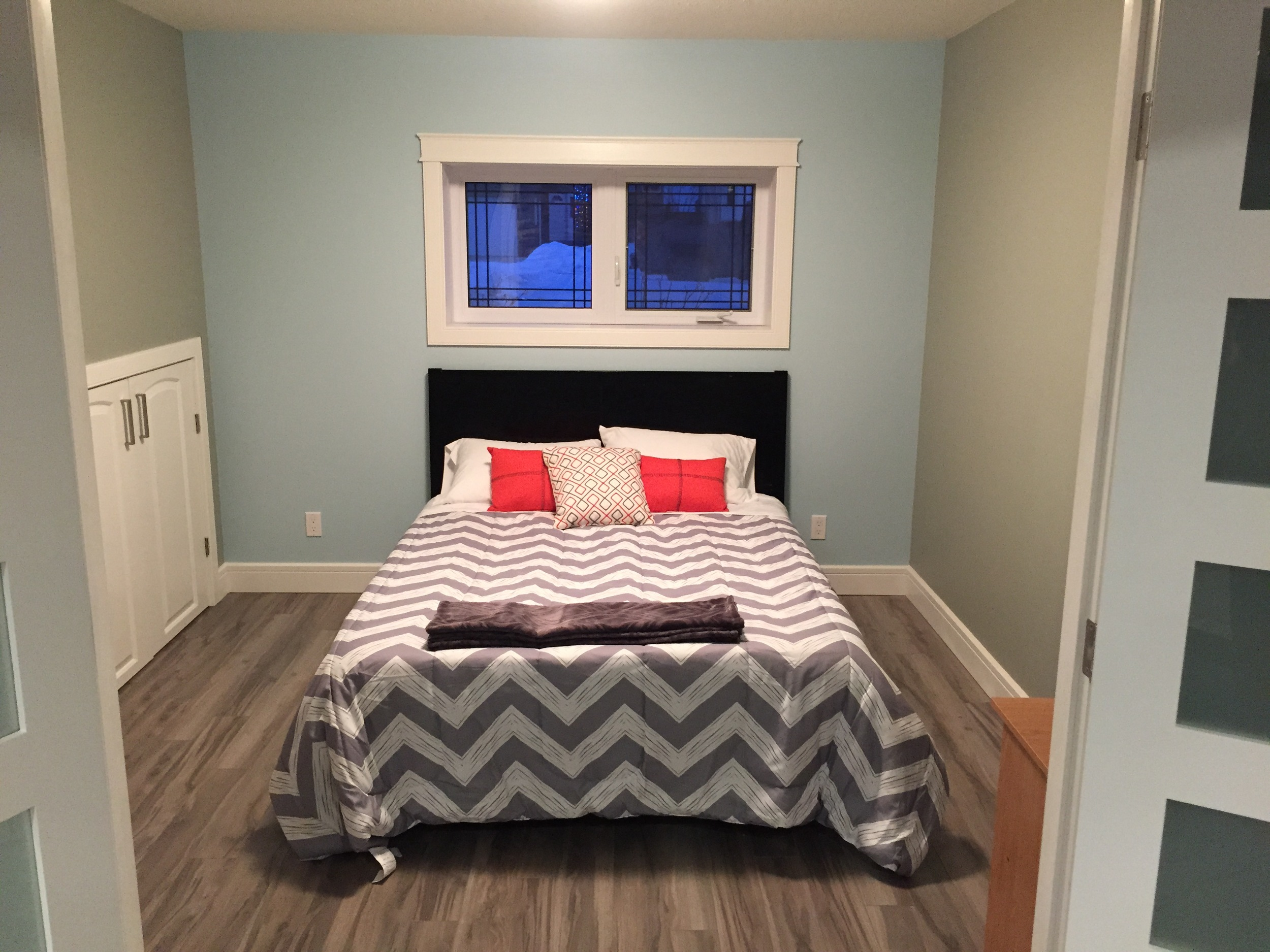 Basement renovation Saskatoon, bedroom, custom closet, french doors, trusted contractor