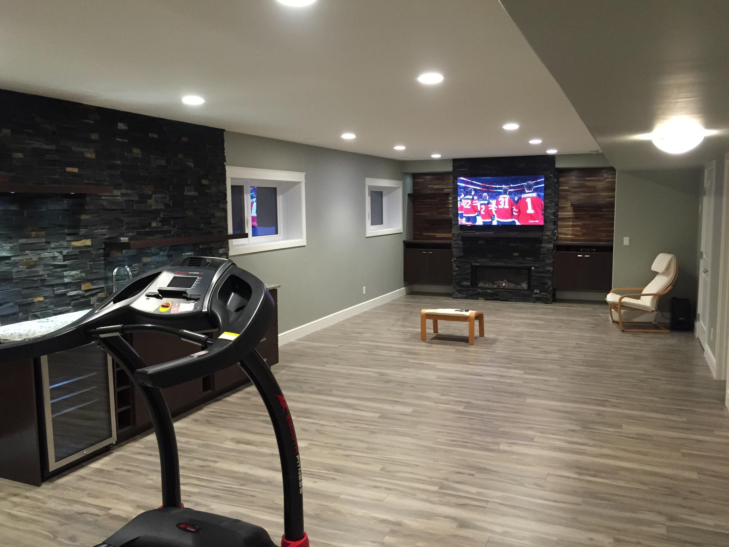 Basement renovation Saskatoon, fireplace,wet bar, stone work, flooring, trusted contractor