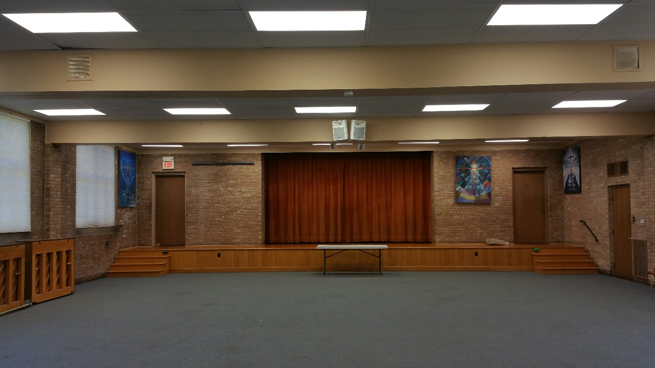 Fellowship Hall-view looking at center stage from center of room.jpg