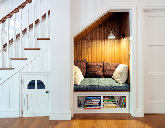 This is a true nook. Being under the stairs isn't so bad all the time (sorry, Sir Harry Potter), especially when it's as comfy and secluded as this one. But what do you think is behind the door on the left? Surely there isn't a house elf taking up residency...
