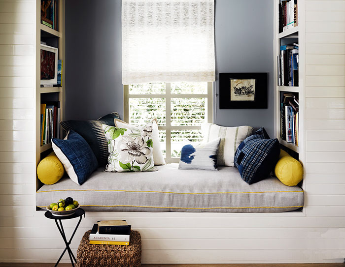 This is a pretty sweet way to fill a built-in space near a front room. In fact, it looks like the one pictured was built specifically to be a reading nook. If your home doesn't have a custom space like this one, we found an easy tutorial (because it has pictures and walks you through each step!) for a DIY custom breakfast nook that you can make into a reading corner, or whatever you want.  Check it out.
