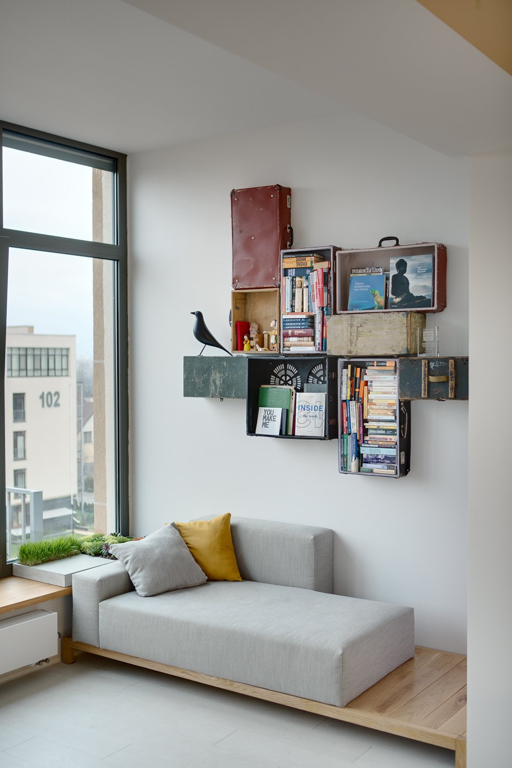 This is more of a project than anything, but if you don't want to be lazy all weekend, it might be something for you. The re-purposed crates and suitcases add a vintage feel to the modern set-up. It's clean and simple, yet the wall decor compliments the art of old-fashioned books and publications instead of swiping through e-book pages on a Kindle or iPad. All hail the feel of paper rustling between your fingers.