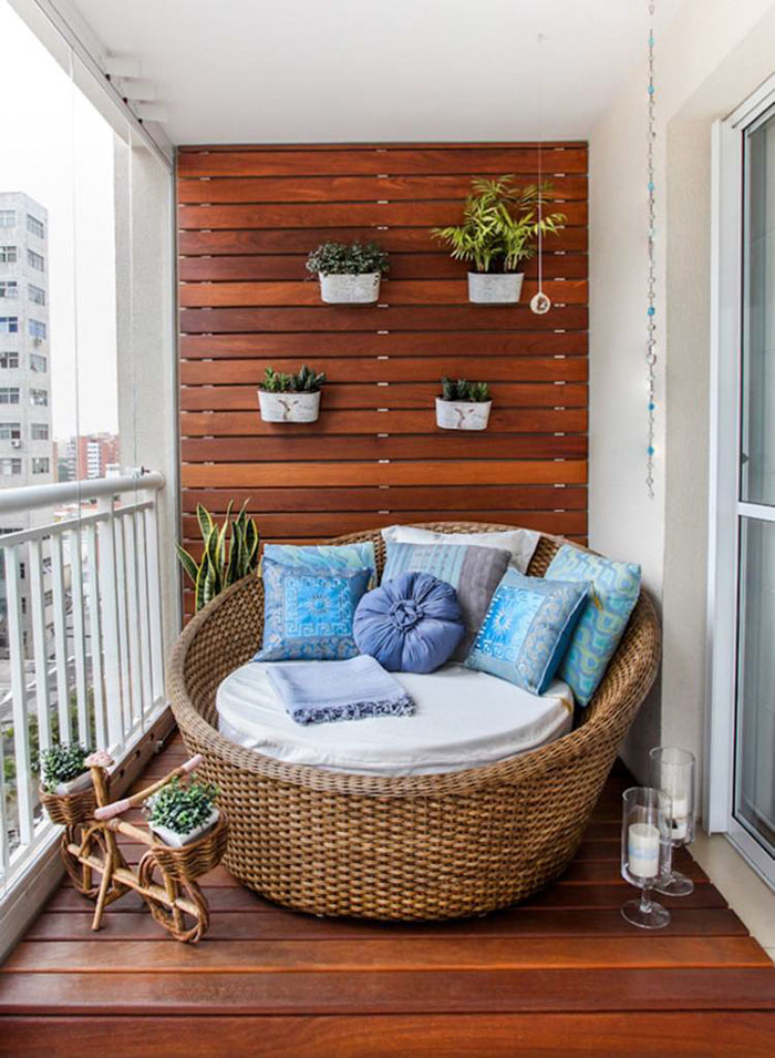 Snuggle up with your cat and take a little snooze. The wood-paneling is impressive in this picture -- besides what's pictured, not much else is needed on the patio (besides you, if you have a chair of this size).