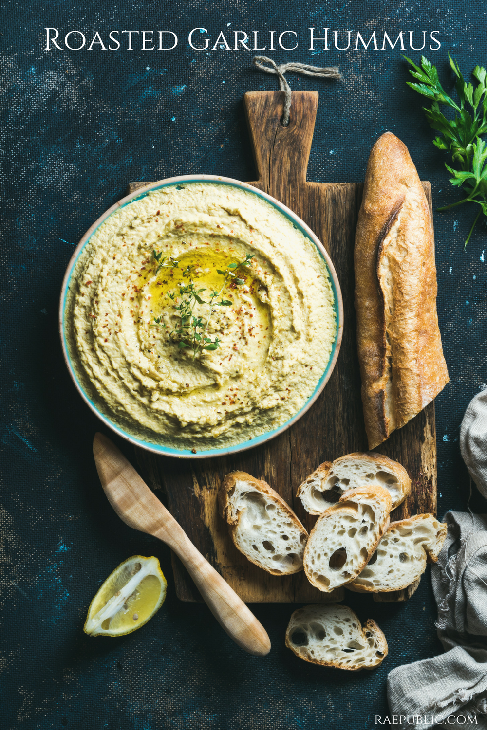 Easy roasted garlic hummus that is naturally gluten free and dairy free.