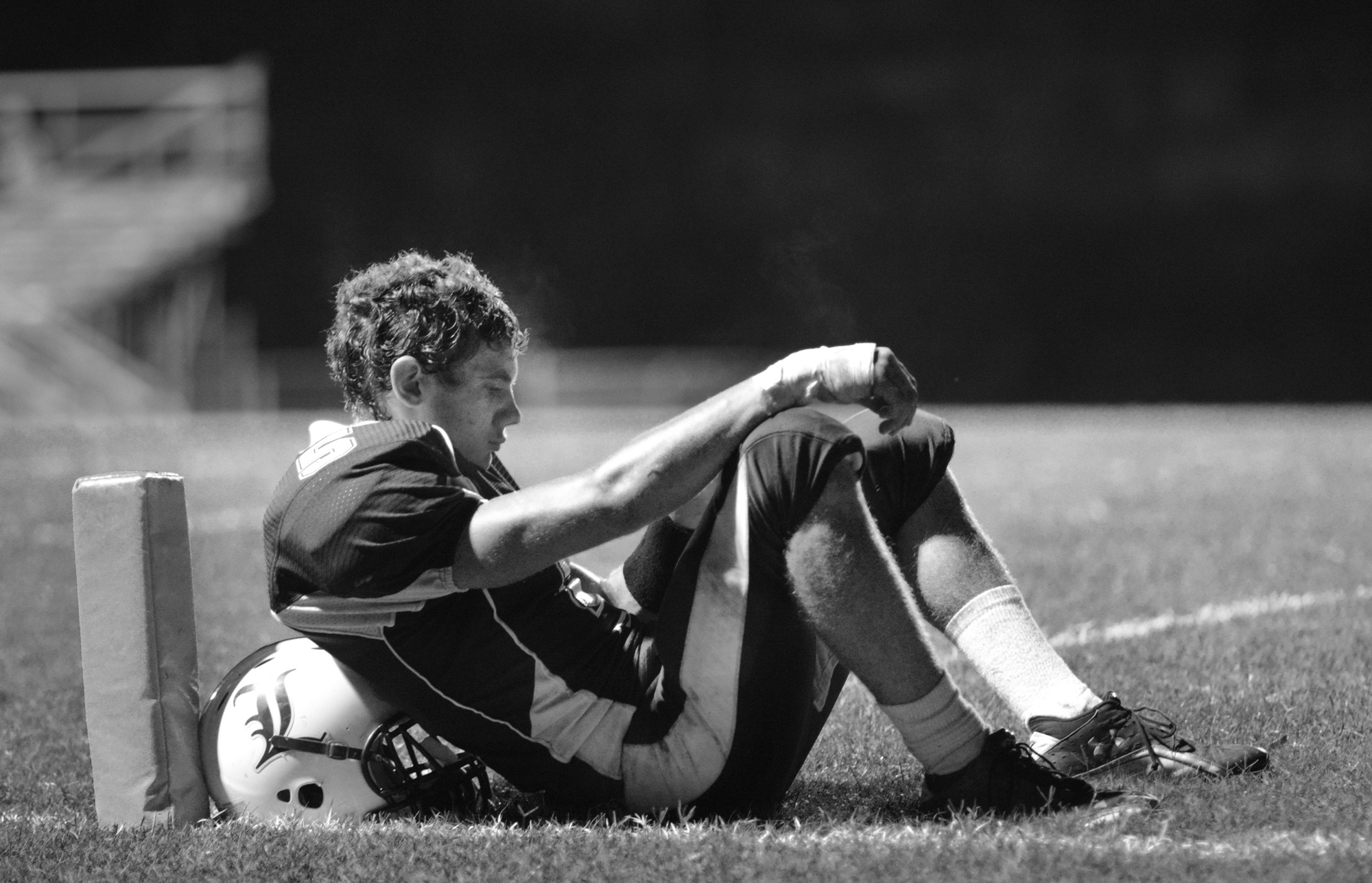 One player pauses before leaving the field.
