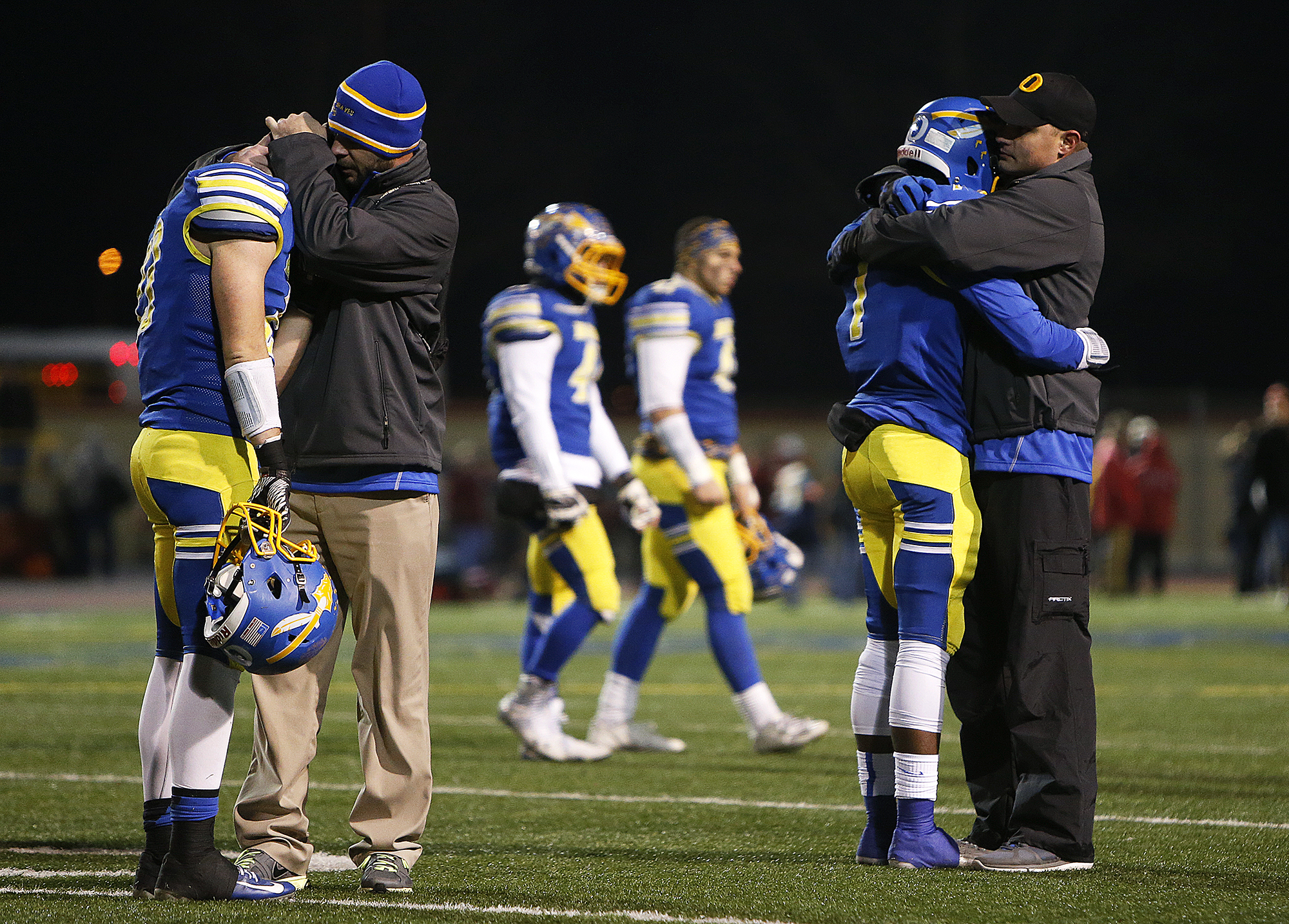 The Olentangy High School Braves react to a rough loss to Cincinnati DeSalle in the division II state semifinals at Welcome Stadium in Dayton, Ohio, Friday, November 28, 2014.