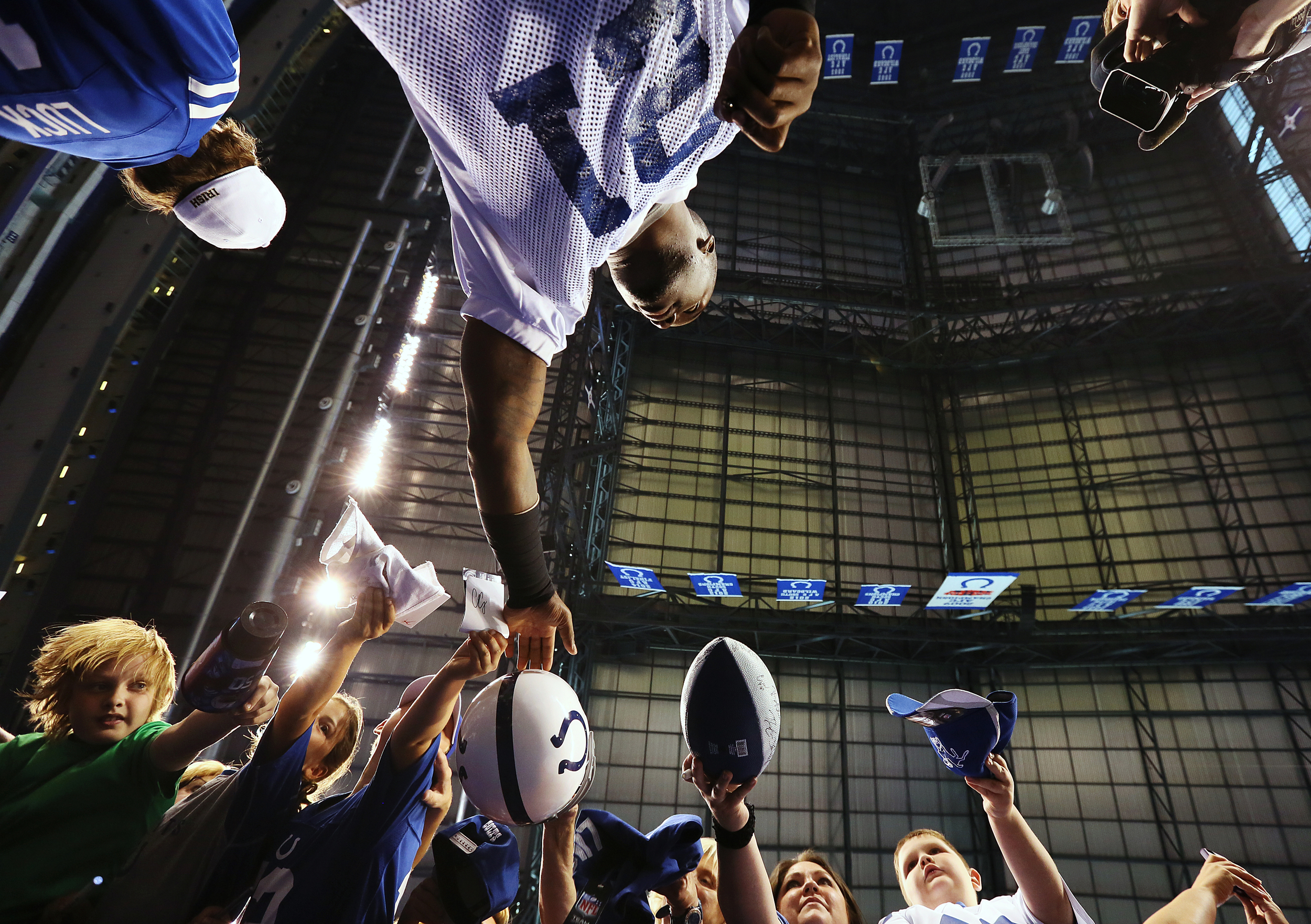Cornerback Vontae Davis (21) signs autographs for fans before public practice at the annual Indianapolis Colts mini-camp and fan open house, Lucas Oil Stadium, Wednesday, June 10, 2015, Indianapolis, Ind.