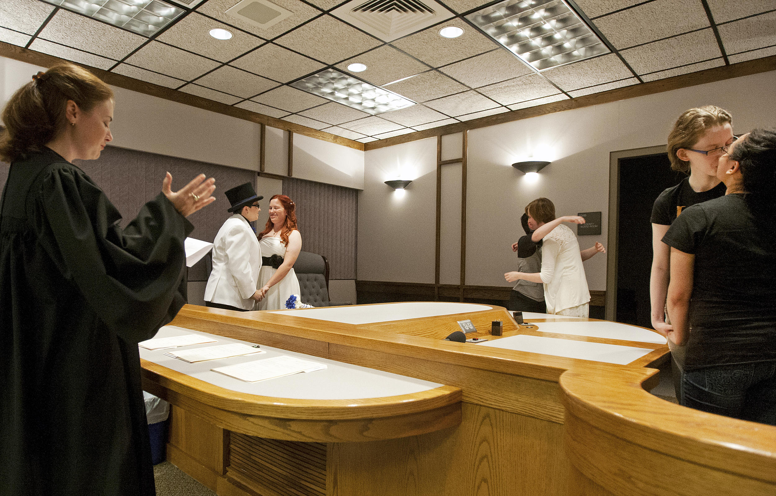 The first three same-sex couples to be legally wed in Polk County, Minn. share a midnight kiss at the Polk County district court in Crookston, Minn., August 1, 2013.