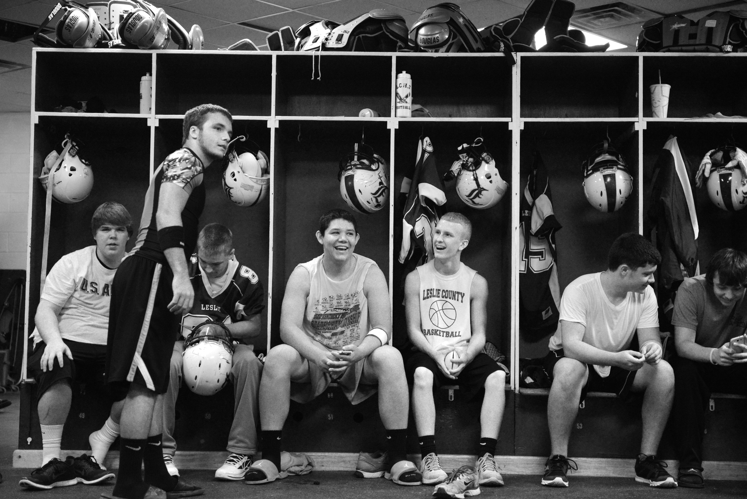 Players socialize in the locker room before taking on Betsy Layne.